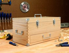 Features:  -Brush nickel hardware with 8 corners brackets.  -Finger joint constructions.  -Removable tray with drawer.  -Material: Solid ash wood.  Product Type: -Toolbox.  Finish: -Natural.  Handle I