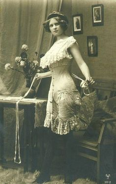 Edwardian lady in underwear, corset with attached garters.