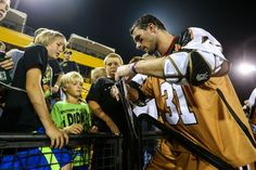 Rochester Rattlers midfielder John Ranagan signs autographs for fans after a game #lacrosse #MLL #lax