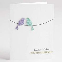 Die-cut love birds on a hand drawn telephone wire for a wedding invitation.