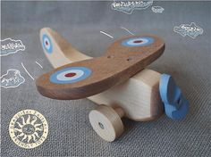 Cute wooden plane! Wooden toys can be a lot of fun for natural kids.