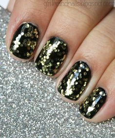 would be totally new years eve nails if you got acrylics, with black til, and then do those gold flakes on top<3