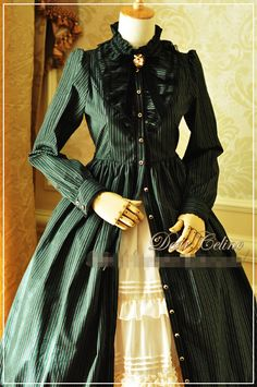 Vintage dark blue lolita op dress, long style and long sleeves, featuring detais oriented stripes. The waist belt is detachable.