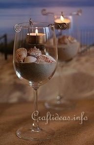 So simple and pretty. Wine glasses, tea light and sand and rocks
