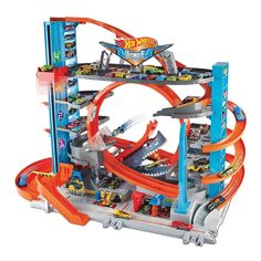 Superb Hot Wheels City Ultimate Garage with Shark Attack Toy Cars Now at Smyths Toys UK. Shop for Hot Wheels Playsets At Great Prices. Hot Wheel Autos, Voitures Hot Wheels, Zip Car, Carros Hot Wheels, Ultimate Garage, Slot Car Tracks, Toys Uk, Hai, Hot Wheels Cars