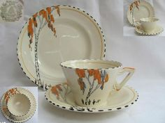 Delightful example of Art Deco style is this colourful trio produced by Burleigh Ware, Burgess & Lee, around The cone shape cup is decorated to one side with an image of a 'tall tree' style . Orange Grey, Burnt Orange, Examples Of Art, Ceramic Tableware, Tea Cup Saucer, Art Deco Fashion, Teacups, Birch, Bliss