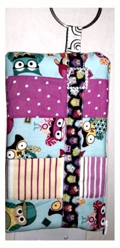 Quilted wristlet I made for my daughter in Owl fabric.  It has a bracelet wrist accessory.  letsgobabygear.com