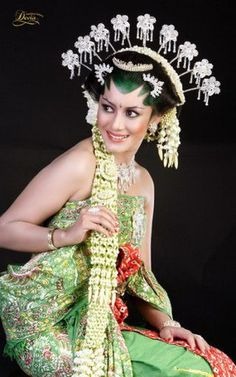 Traditional wedding look from Java, Indonesia.