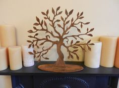 Rusty Metal Art - Tree of Life - Medium 28cm - A great gift for Mothers Day  This elegant hand made Tree of Life sculpture will take pride of place on your mantelpiece, table top or a window sill.  Full of attractive detail, this piece would also make a wonderful gift. The rusty patina gives a natural and individual finish, adding to the beauty of the piece, giving a depth and warmth to each individual leaf.  It stands at 28cm in height, 31cm width (we have created a larger version at 38cm…