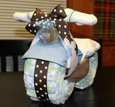 Hey, I found this really awesome Etsy listing at http://www.etsy.com/listing/106632174/motorcycle-diaper-cake-baby-shower-gift