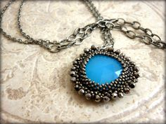 Blue Chalcedony (hydro*) bezeled with seed beads and embellished with pyrite