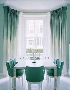Mint colored dining room. Lovely pale pale blue green pastel.  Notice the ombre drapes! http://cococozy.com