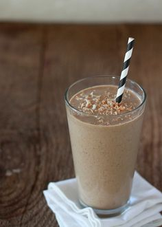 Toasted Coconut Coffee Smoothie:  ¼ cup sweetened flaked coconut plus a little more for garnish, if desired 1 cup canned lite coconut milk ½ cup coffee, frozen into ice cubes 1 large banana, frozen (slice the banana before freezing for easier blending later on) 2 tablespoons ground flaxseed 1 teaspoon vanilla extract