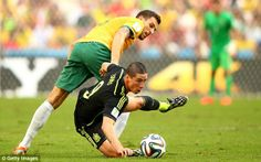 Floored: Torres goes to ground under the challenge of Matthew Spiranovic...