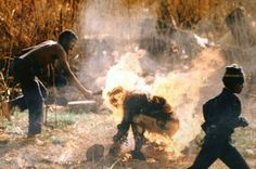 """Kevin Carter was the first photographer to take images of the """"necklacing"""" in South Africa in the mid Kevin Carter, New York Times, African National Congress, Fotojournalismus, Jamel, Human Torch, Iconic Photos, Amazing Photos, The Victim"""