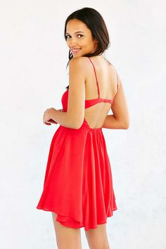 $49.99Silence + Noise Noir Strappy-Back Mini Dress - Urban Outfitters