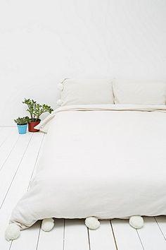 Bettbezug mit Bommeln in Elfenbein