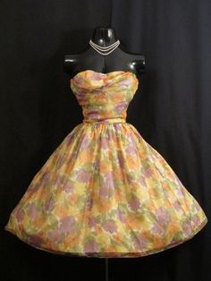 Description  An absolutely lovely 1950's strapless party dress in an exquisite color combination of sunflower yellow, moss green, lilac and
