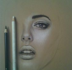 Looks like pastel pencils-nicely drawn face.