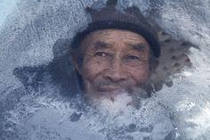 A cold day by Alessandra Meniconzi - A man looks from a car's window on a desolate and freezing winter day