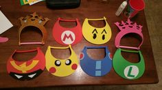 Super Smash Bros birthday party foam visors. Princess Peach, Mario, Pacman, generic pink crown, Captain Falcon, Pikachu, Megaman, and Luigi. Still working on a design for Sonic since I have one more blue visor left.