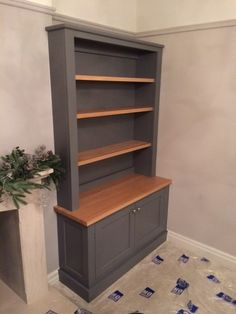 Bespoke fitted bookcase within an alcove with oak adjustable shelves and internals and a grey painted external cabinet colour. Living Room Cupboards, Built In Shelves Living Room, Dining Room Shelves, Living Room Storage, Living Room With Fireplace, Home Living Room, Alcove Storage, Alcove Shelving, Oak Shelves