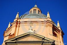 Photo made at the dome of a church that is located close to Piazza Maggiore in the town center in Bologna in Emilia Romagna (Italy). In the picture you see a side of the dome with the lantern lit by the sun of a winter day and outlined the blue of the sky.