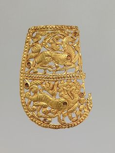Clothing Plaque with Antelope and Tiger | China (Xinjiang Autonomous Region, Central Asia) | Period of Tibetan Empire | The Metropolitan Museum of Art