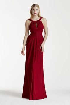 You'll earn plenty of double takes in this simple and chic velvet keyhole halter dress!  Halter bodice features alluring keyhole detail and ruching.  Long and luxe velvet sheath dress features a fishtail back.  Fully lined. Imported polyester. Back zipper. Dry clean only.