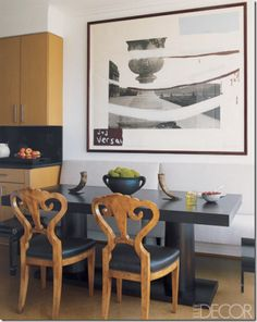contemporary eat-in kitchen ...warmed with sculptural Biedermeier chairs....& art