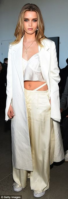 White hot!Dressed to impress, the former Victoria's Secret model stunned in a white crop top teamed with cream coloured trousers, with a crisp white blazer added on top to add a sophisticated touch