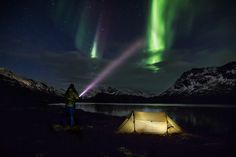 Did you know that you can communicate with northern lights? You just flicker at them with a flash light - and they'll flicker right back!  Photo by Mads Pihl