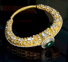 Dazzle yourself up with this Royal Husli Rajasthani necklace in gold and uncut diamonds.