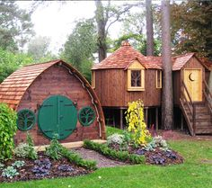 High Life Tree Houses's Hobbit hole and elfin tree house. Lucky kids.