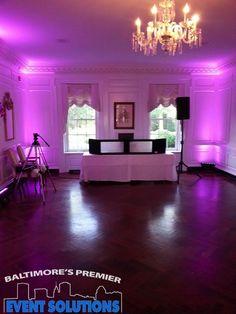 DJ setup with uplighting for wedding reception