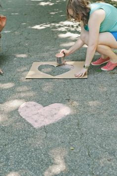 sidewalk chalk hearts leading up to ceremony