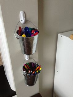 Keep your kid's crayons and markers organized using mini pails and Command™ Brand Hooks!