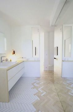 This is a nice way to transition from hard wood to tile when there aren't doors to separate the bedroom from the bathroom,