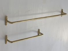 Brass towel bars bar Oji & Design - I like towel bars with slim rectangular attachment to wall like this, not round. I find the round shapes distracting. I know, picky picky ...