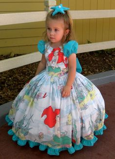 vintage Little Mermaid bed sheet and the sleeves, bow, ruffle and starfish hair clip were made from an upcycled medical scrub top. Both were by echkbet