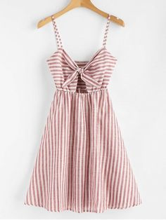 Smocked Knotted Stripes Dress. With an allover adorable stripes pattern and a subtle empire waist, this cami dress is a perfect pick for every event on your day-to-night calendar. A tie-front design that creates a slight cutout detailing on the bodice and the stretchy smocked back add a little flirty feel to the casual style. Just pair it with heels to show off a bit. #Zaful #Dress #Outfits