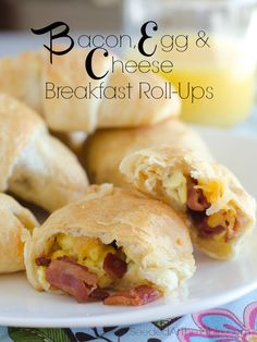 Bacon, Egg & Cheese rolled into refrigerated crescent rolls for a breakfast in one! by http://www.seededatthetable.com/2014/01/23/bacon-egg-and-cheese-breakfast-roll-ups/
