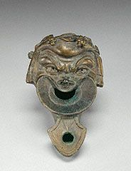Roman bronze lamp in form of a comic slave's mask. I century CE. Ancient Rome, Ancient Art, Stock Character, Cleveland Museum Of Art, Archaeological Finds, Getty Museum, Roman History, Museum Collection, A Comics
