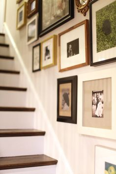 Framed photos up staircase