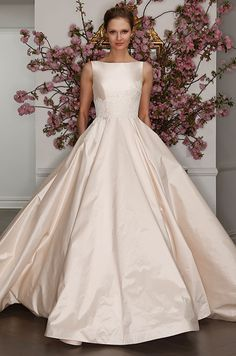 Blush silk ball gown with boat-neckline and lace applique accents on the bodice. Legends Romona Keveza Spring 2017 Bridal Collection
