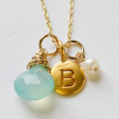 Image from http://cdn.shopify.com/s/files/1/0190/8688/products/gold_monogram_layer_necklace_1_large.jpg?v=1351800739.