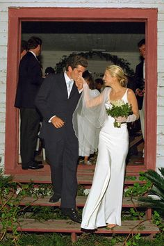 Carolyn Bessette and John F. Kennedy, Jr., were married on September 21, 1996. The former Calvin Klein publicist wed America's Most Eligible Bachelor by candlelight in a small wooden chapel on Georgia's remote Cumberland Island. The poster girl for understated chic, Bessette wore a bias-cut Narciso Rodriguez gown and Manolo Blahnik sandals and carried a bouquet of lilies of the valley.     Photo: Denis Reggie  http://www.davidpressmanevents.com