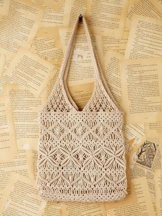 Vintage crochet macrame handbag--my first purse looked just like this!Free People Vintage Macrame Handbag in Beige (white)I still have this exact purse I store old needle point in it Maybe I could recreate it. Macrame Design, Macrame Art, Macrame Projects, Macrame Knots, Macrame Jewelry, Macrame Supplies, Crochet Handbags, Crochet Purses, Crochet Bags