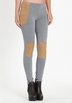 Leggings that look like pants in a heather gray color. Suede toffee accents and horizontal stitching on the hips and knees. Skinny fit. Elasticity at waist. By Mink Pink.    Was $64.00  Sale $53.50