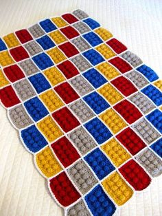 DIY Crocheted LEGO Blanket : FREE pattern, and video:   http://www.allfreecrochet.com/Crochet-Afghan-Patterns/Lego-Block